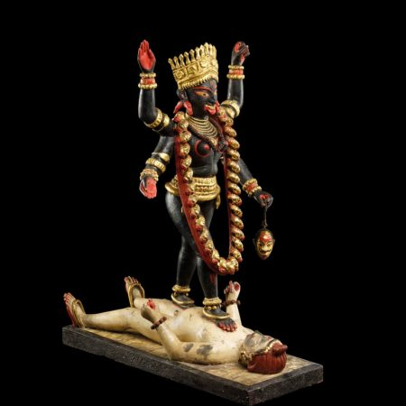 Painted and gilded clay figure of Kali striding over Shiva, Bengal, Eastern India, late 19th century. © The Trustees of the British Museum